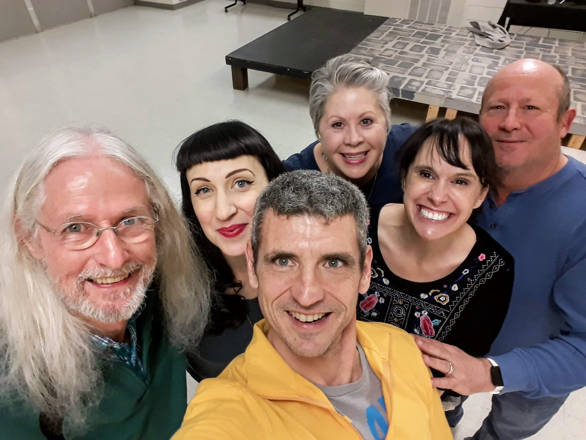 Six adults taking a selfie